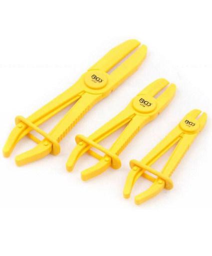 driedelige set gele leidingklemmen